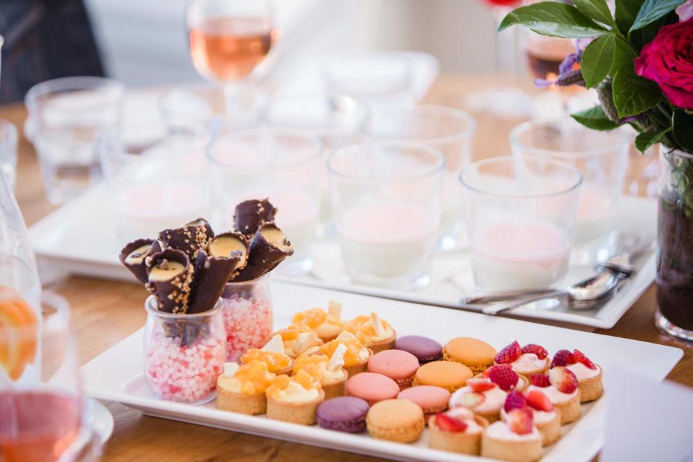 Spread of dessert bites including macarons and mini tarts