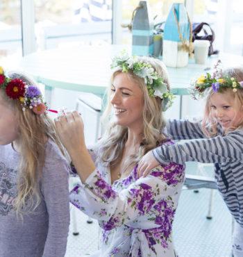 Girls making flower crowns at school holidays workshop