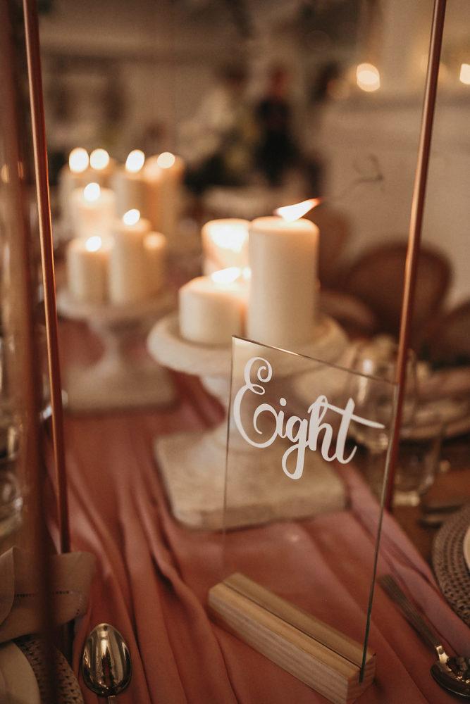 candles with mahogany backdrop and acrylic signage