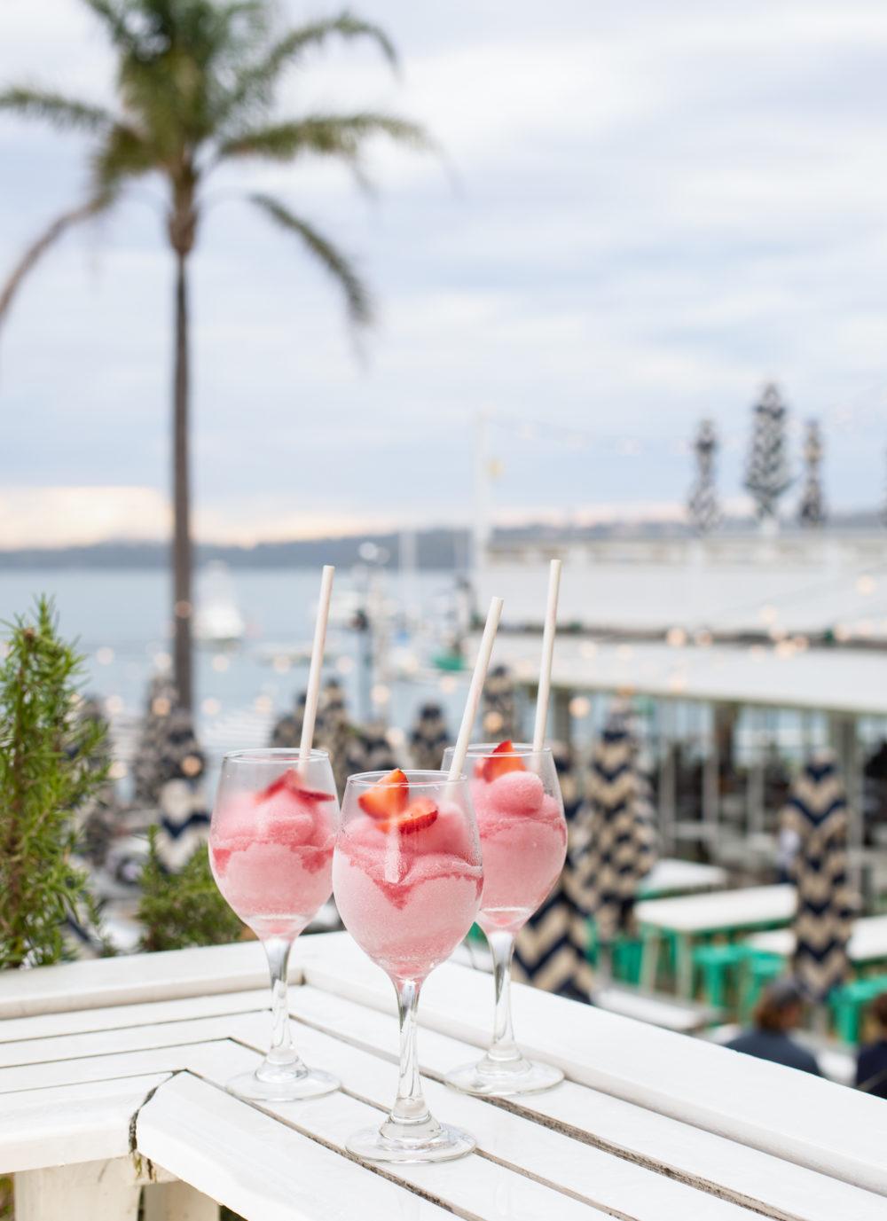3 Pink Frozen Cocktails overlooking the beach