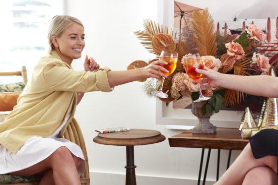Lady cheersing aperol