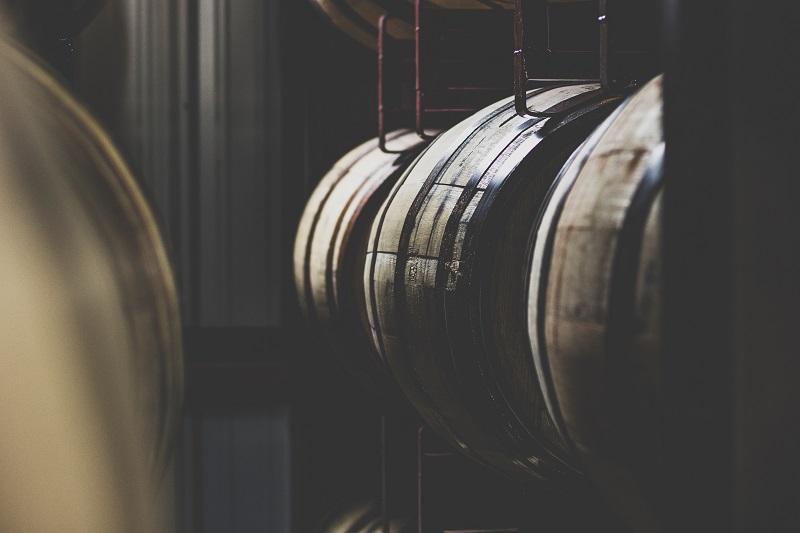 Barrels of Gin in a dark room