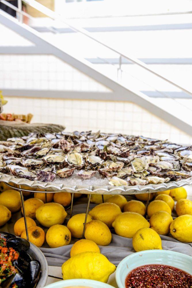 oysters on salt with lemons underneath